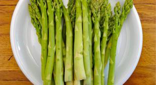 Asparagus stems in a plate, ready for dinner.