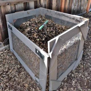 Composter built from planks and mesh wire