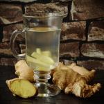 A cup of ginger tea with ginger roots to beat the winter.