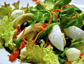 An egg and lettuce salad looking delicious and healthy.