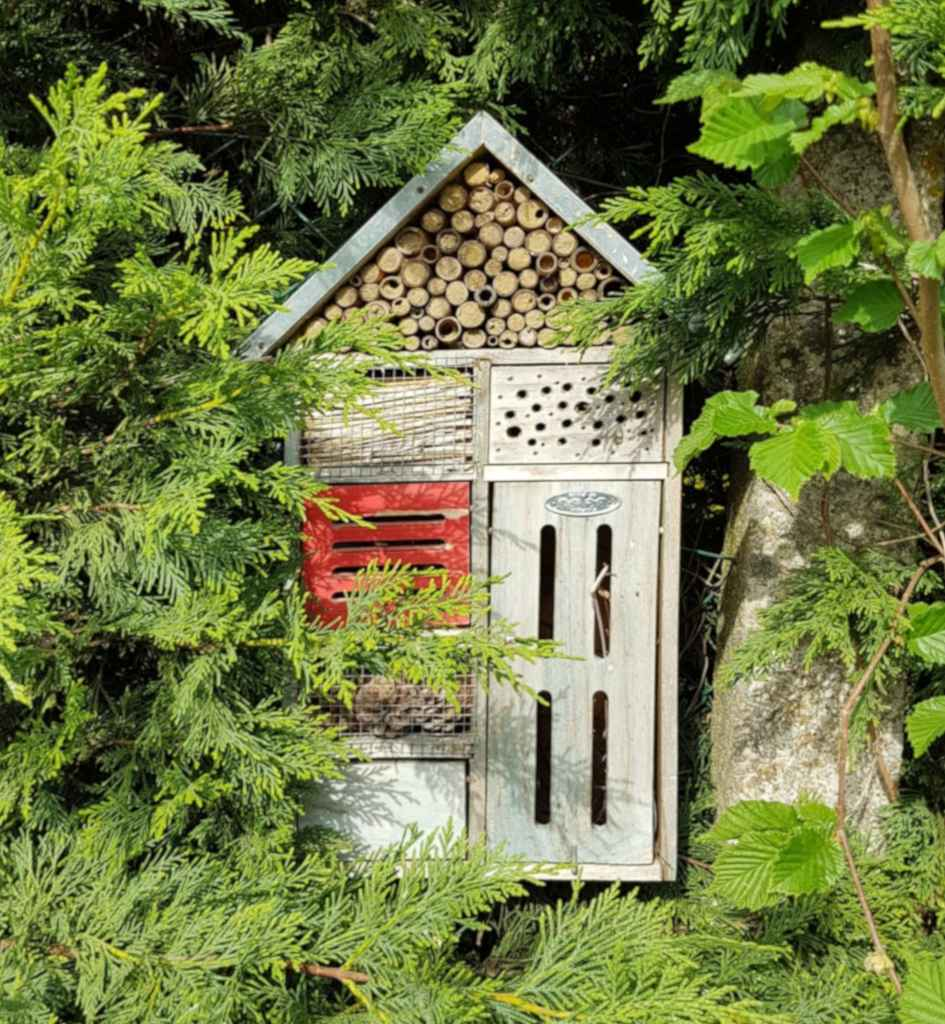 A deluxe insect hotel with holes, nooks and crannies for insects.