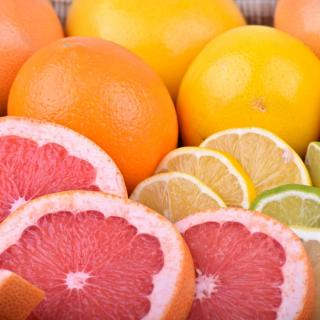 Citrus fruits, some of which are sliced.