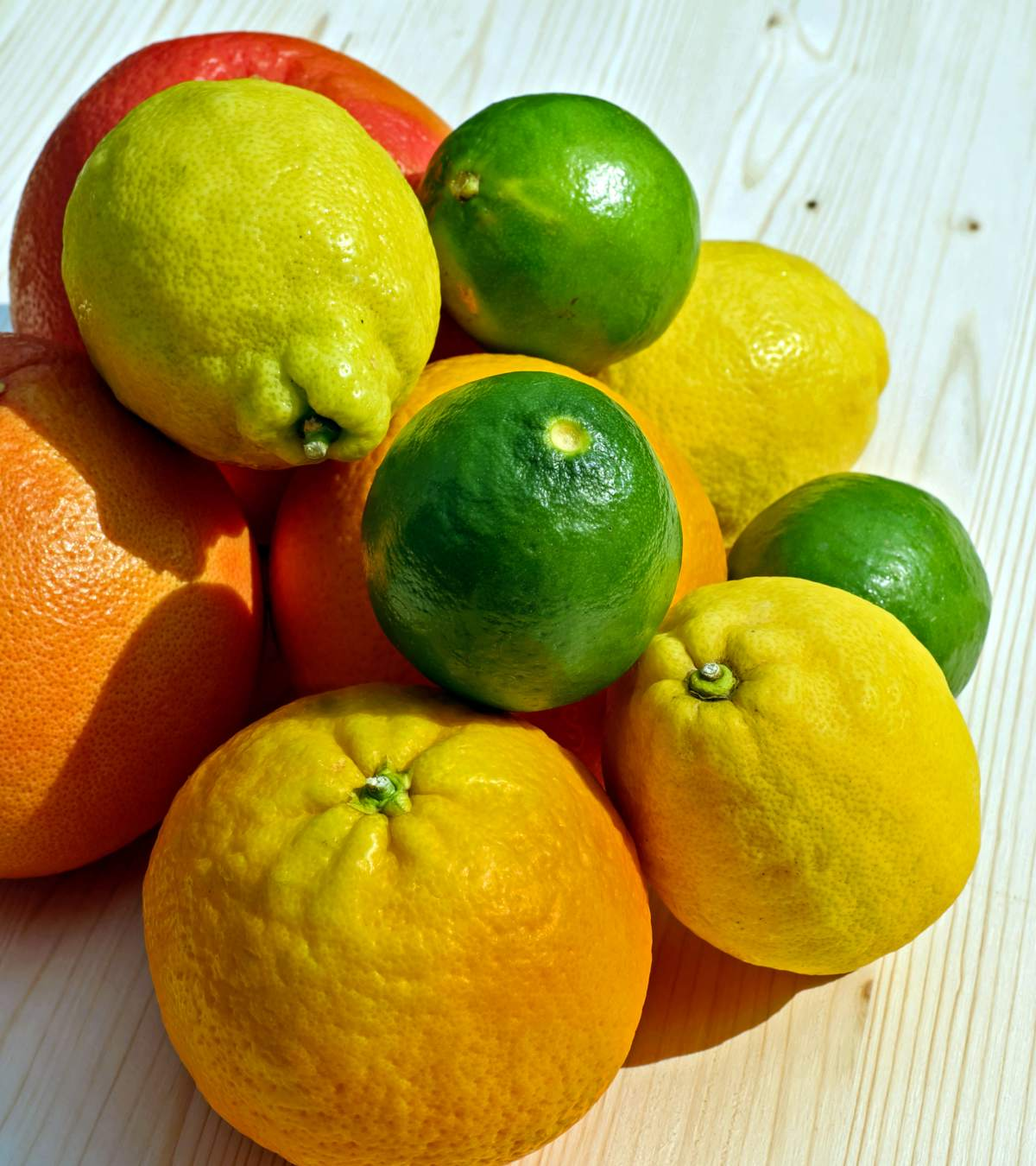 A stack of different citrus fruits