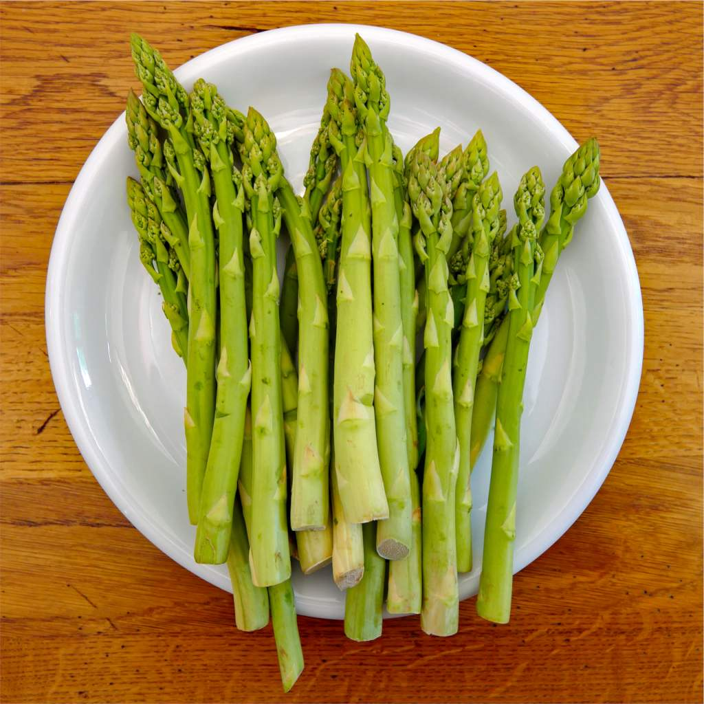 Asparagus stems in a plate, ready for dinner.