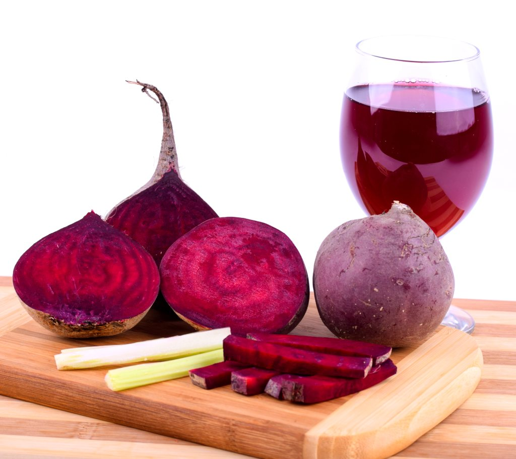 Different ways of preparing red beet: juice, sliced, sticks
