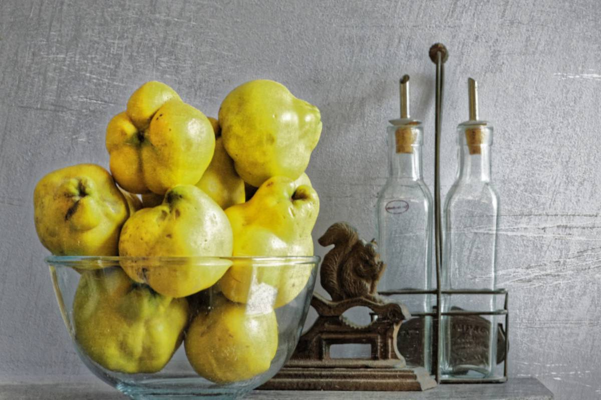 Quince fruit in a basket with spices