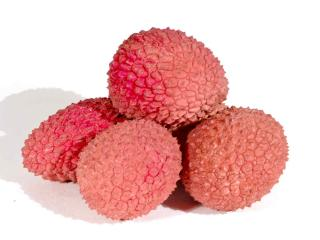 Health benefits of lychee, a small pile of fruit against a white background