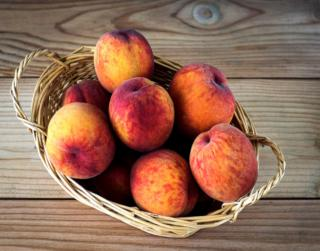 Peaches in a basket, ready for a delicious bite of health benefits