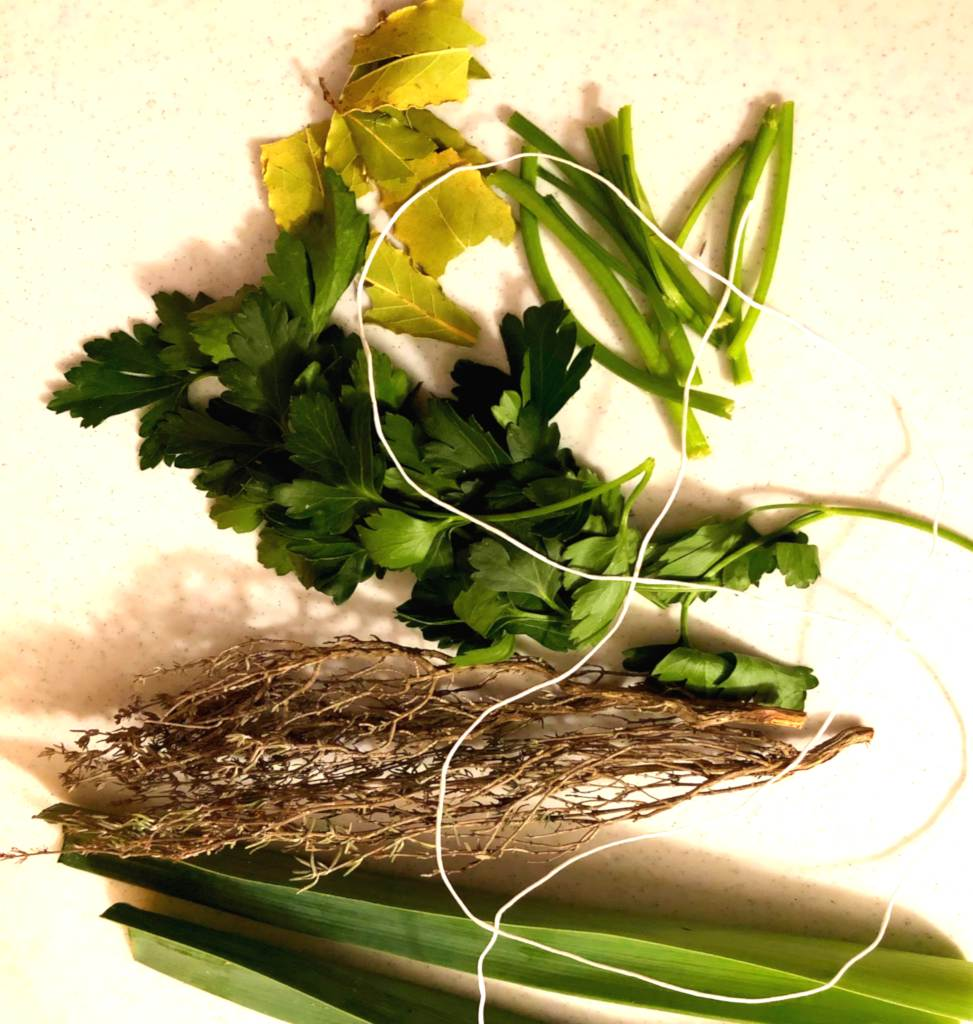 Bouquet garni ingredients: thyme, bay laurel, leek greens, parsley, rosemary (not shown).