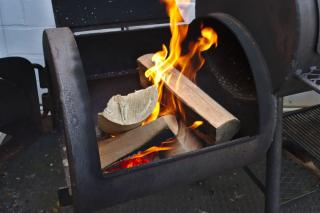 Best is wood ash, like these logs in a smoker