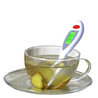 Cup and saucer with thermometer and ginger