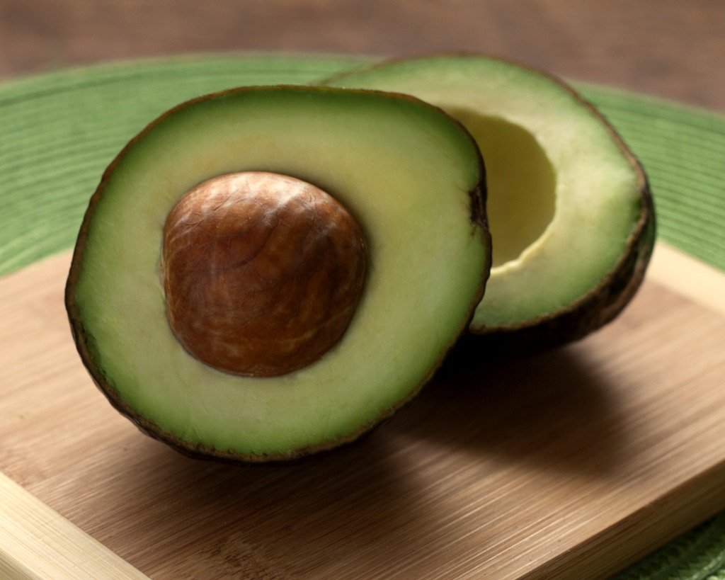 Raw avocado sliced in two is very healthy.