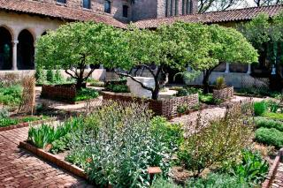 A cloister garden with herbs and prayer.