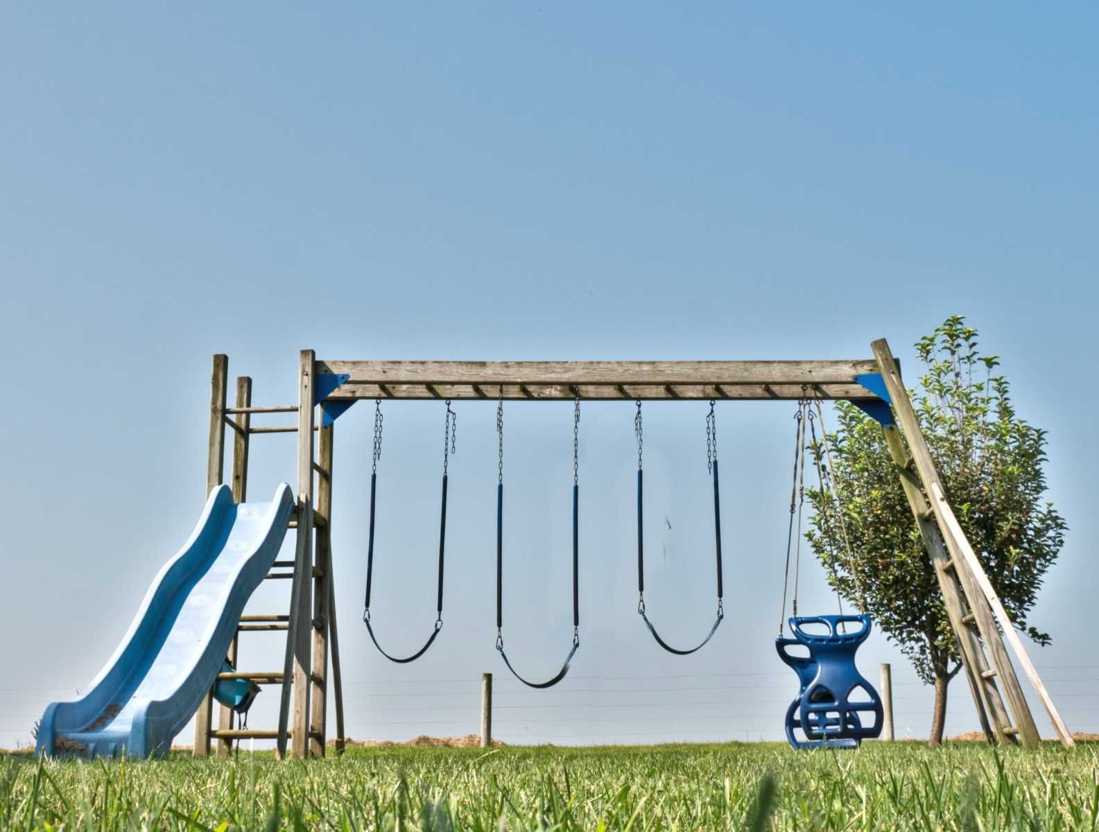 Wooden swingset with 5 activities.