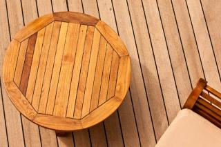 Deck, chair and table all made from cheap wood.