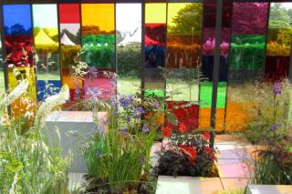 Colorful garden with plants and ornaments